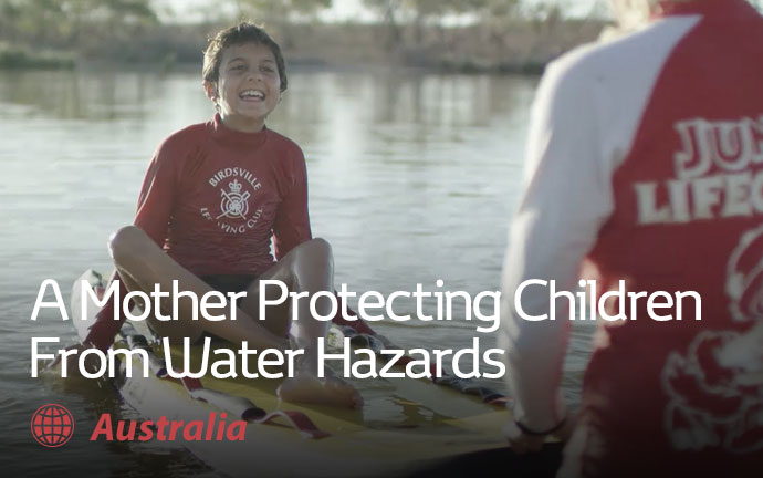 A Mother Protecting Children From Water Hazards